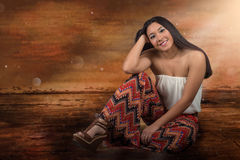 Beautiful mixed race woman sitting on the floor Stock Images