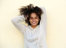 Beautiful mixed race woman smiling with hand in hair Royalty Free Stock Photos