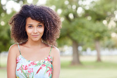 Beautiful mixed race woman smiling sweetly in a park Stock Photography