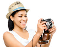 Beautiful mixed race woman taking photograph vintage camera isol Stock Images