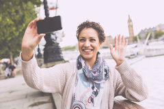 Beautiful mixed race woman taking a selfie in London Stock Photos