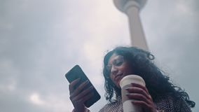 Beautiful Mixed race woman using smart phone technology app living urban happy lifestyle on the background of the Berlin stock video