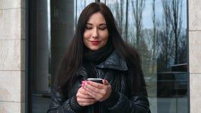 Beautiful mixed race woman using smart phone technology app walking through city streets urban happy stock video