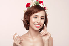 Beautiful model applying cosmetic cream treatment on her face on Royalty Free Stock Image