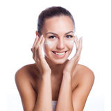 Beautiful model applying cosmetic cream treatment Stock Images