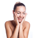 Beautiful model applying cosmetic cream treatment Stock Image