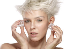 Beautiful model applying an ice beauty treatment on the skin Stock Photography