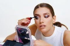 Beautiful model applying make up. Beautiful face model girl applying make up royalty free stock images