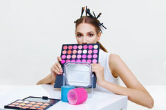 Beautiful model applying make up. Beautiful face model girl applying make up stock photos