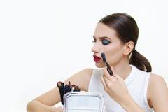 Beautiful model applying make up. Beautiful face model girl applying make up stock photography