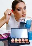 Beautiful model applying make up. Beautiful face model girl applying make up stock photo