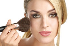 Beautiful model applying professional make up using a brush Stock Photo