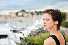 Beautiful model on the balcony of Palais des Festi. Vals in Cannes, France Royalty Free Stock Photos