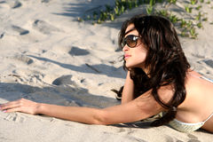 Beautiful model on the beach l Stock Images