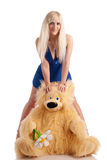 Beautiful model with a bear in hands Stock Photos