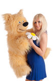 Beautiful model with a bear in hands Royalty Free Stock Images