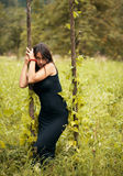 Beautiful model in black. Portrait of beautiful model in black on nature background, posing Stock Photos