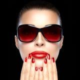 Beautiful Model in Black Fashion Sunglasses. Bright Makeup and M. Beautiful fashion model girl with stylish oversized sunglasses. Bright makeup and manicure Royalty Free Stock Photo