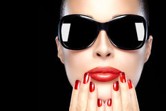 Beautiful Model in Black Fashion Sunglasses. Bright Makeup and M Royalty Free Stock Image