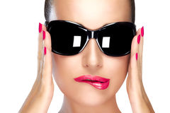 Beautiful Model in Black Fashion Sunglasses. Bright Makeup and M. Beautiful fashion model girl with stylish oversized black sunglasses. Bright makeup and Royalty Free Stock Photo