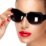 Beautiful Model in Black Fashion Sunglasses. Bright Makeup and M Royalty Free Stock Photo