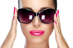 Beautiful Model in Black Fashion Sunglasses. Bright Makeup and M. Beautiful fashion model girl with stylish oversized black sunglasses. Bright makeup and Royalty Free Stock Photography