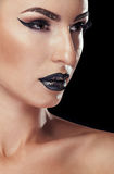 Beautiful model with black make up Royalty Free Stock Photography