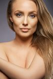Beautiful model with blond hair looking at camera Royalty Free Stock Photo