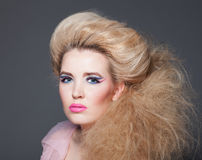 Beautiful model the blonde with a creative hairdress and a makeup Royalty Free Stock Images