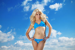 Beautiful Model in blue bikini. With long curly Blond hair Stock Image