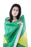 Beautiful model with Brazilian flag Stock Images