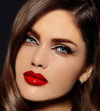 Beautiful model with bright makeup with red lips Stock Image