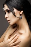 Beautiful model brunette with long curled hair Stock Photography