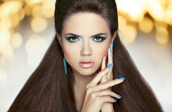 Beautiful model brunette with makeup, long hair. Manicured nails Royalty Free Stock Photos