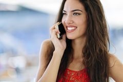 Beautiful model calling on phone royalty free stock image