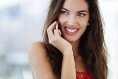 Beautiful model calling on phone Royalty Free Stock Photo