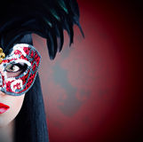 Beautiful model in carnival mask with red lips Royalty Free Stock Images
