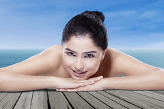 Beautiful model with clean skin at beach Royalty Free Stock Photo