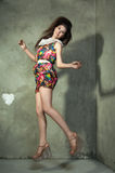 Beautiful model in colorful dress jumping, concept of joy, happi Royalty Free Stock Photos