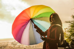Beautiful model with colorful umbrella Royalty Free Stock Image