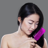 Beautiful model combing her hair Stock Images