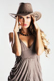 Beautiful model in cowboy's hat Stock Photos