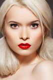 Beautiful model with creative hairstyle & make-up. Portrait of chic beautiful woman model with creative modern backcombed hairstyle, bright red lipstick with royalty free stock photo