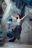 Beautiful model dancing with blue fabrics. Stock Photo