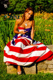 Beautiful model draped in the American Flag. Stock Photos