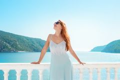 Content woman chilling on tropical terrace royalty free stock image