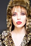 Beautiful model dressed only in elegant leopard fur and hat. Beautiful model dressed only in elegant leopard fur and hat Royalty Free Stock Photography