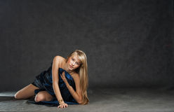 Beautiful model dressed in fabrick laying on floor Stock Photography