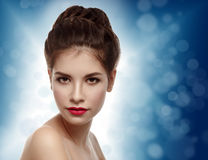 Beautiful model with elegant hairstyle. Christmas background. Wi Stock Photo