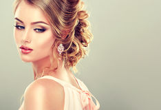 Beautiful model with elegant hairstyle .